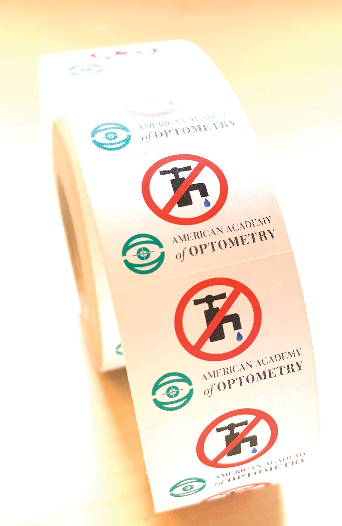 "Fig. 3. These ""no water"" stickers, distributed by the American Academy of Optometry, can help reinforce to patients that no amount of water exposure is acceptable."